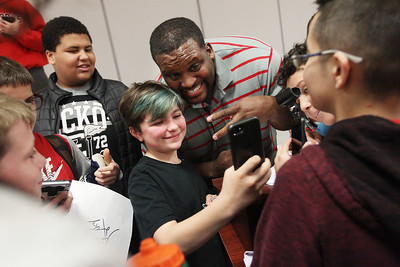 "Candace H. Johnson-For Shaw Media Fifth grader Brianna Duran, 11, of Fox Lake takes a selfie with Anthony ""Spice"" Adams, former Chicago Bear, and co-host of Inside the Bears, after he gave an inspirational talk to students about his life on and off the football field at Stanton Middle School in Fox Lake."