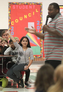 "Candace H. Johnson-For Shaw Media Fifth grader Dayane Segundo, 10, waits to ask Anthony ""Spice"" Adams, former Chicago Bear, and co-host of Inside the Bears, a question as he gives an inspirational talk to students about his life on and off the football field and making good choices at Stanton Middle School in Fox Lake."