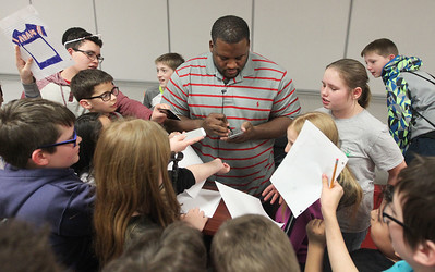 "Candace H. Johnson-For Shaw Media Anthony ""Spice"" Adams, former Chicago Bear and co-host of Inside the Bears, signs autographs for students after giving an inspirational talk about making good choices and his life on and off the football field at Stanton School in Fox Lake."