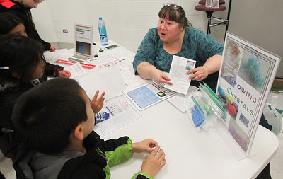 Candace H. Johnson-For Shaw Media Merlanne Rampale, of Prairie View, education director and outreach for SWALCO, hands out crystal making kits during the Scouts of Gurnee Science Jam-STEAM Night at Woodland Middle School in Gurnee.(4/11/18)