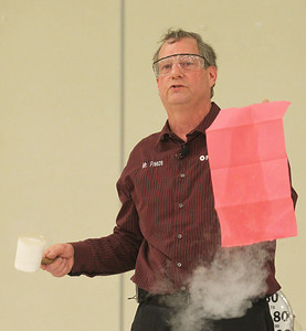 Candace H. Johnson-For Shaw Media Jerry Zimmerman, of Batavia (Mr. Freeze) shows what happens when liquid nitrogen is poured on a piece of paper during a cryogenic demonstration presented by Fermilab during the Scouts of Gurnee Science Jam-STEAM Night at Woodland Middle School in Gurnee.(4/11/18)