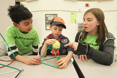 Candace H. Johnson-For Shaw Media Liam Sisulak, 7, of Grayslake (center) with Cub Scout Pack 671 works on building a tower using straws, pipe cleaners and marshmallows to hold a tennis ball with the help of Dhruval Bhatt, 14, and Shannon Mahoney, 13, both of Gurnee, with the Woodland Science Olympiad Club during the Scouts of Gurnee Science Jam-STEAM Night at Woodland Middle School in Gurnee.(4/11/18)