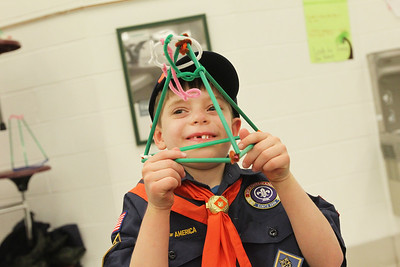 Candace H. Johnson-For Shaw Media Liam Sisulak, 7, of Grayslake with Cub Scout Pack 671 holds a tower he built using straws, pipe cleaners and marshmallows to hold a tennis ball during the Scouts of Gurnee Science Jam-STEAM Night at Woodland Middle School in Gurnee.Liam was able to build the tower with help from students in the Woodland Science Olympiad Club.(4/11/18)