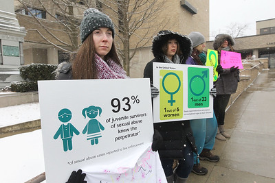 """Candace H. Johnson-For Shaw Media Ashley Dawson, of Wauconda stands with staff, volunteers and community members as they hold up signs during the Zacharias Sexual Abuse Center's """"Standing Silent Witness,"""" protest for Sexual Assault Awareness Month outside of the Lake County Courthouse in Waukegan.(4/9/18)"""