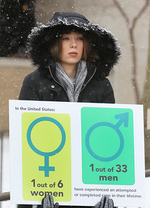 """Candace H. Johnson-For Shaw Media Kyle Malcolm, of Mundelein holds a sign during the Zacharias Sexual Abuse Center's """"Standing Silent Witness,"""" protest for Sexual Assault Awareness Month as she stands outside of the Lake County Courthouse in Waukegan.(4/9/18)"""