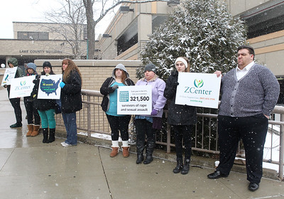 """Candace H. Johnson-For Shaw Media Staff, volunteers and community members hold up signs during the Zacharias Sexual Abuse Center's  """"Standing Silent Witness,"""" protest for Sexual Assault Awareness Month as they stand outside of the Lake County Courthouse in Waukegan.(4/9/18)"""