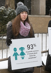 "Candace H. Johnson-For Shaw Media Ashley Dawson, of Wauconda holds a sign during the Zacharias Sexual Abuse Center's ""Standing Silent Witness,"" protest for Sexual Assault Awareness Month as she stands outside of the Lake County Courthouse in Waukegan.(4/9/18)"