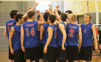 Candace H. Johnson-For Shaw Media Lakes boys varsity volleyball players come together in a huddle before playing Grayslake North at Grayslake North High School. Lakes won 25-22, 25-18.(4/17/18)