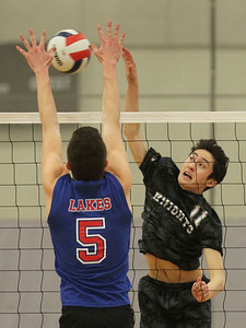 Candace H. Johnson-For Shaw Media Lakes Eric Jones blocks a shot by Grayslake North's Marshal Diep in the first set at Grayslake North High School. Lakes won 25-22, 25-18.(4/17/18)