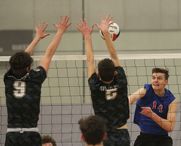 Candace H. Johnson-For Shaw Media Grayslake North's Sage Lawson and Nick Anello block a shot by Lakes Clayton Nix in the second set at Grayslake North High School. Lakes won 25-22, 25-18.(4/17/18)