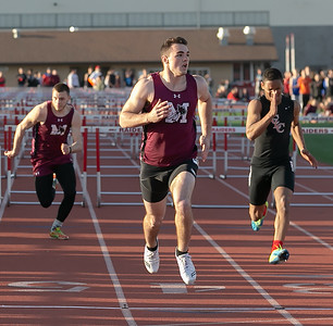 Marengo's Finn Schirmer wins the 110 meter hurdles Friday, April 20, 2018 at the McHenry County Track and Field Championship in Huntley. KKoontz – For Shaw Media