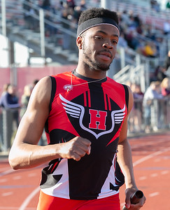 Huntley's Dubem Anikamadu takes the first leg in the 4x100 Meter Relay Friday, April 20, 2018 at the McHenry County Track and Field Championship in Huntley. Anikamadu along with teammates Eric Mooney, Zach Tepper, Antonio Passarelli, set a new county record with a time of 41.49.  KKoontz – For Shaw Media