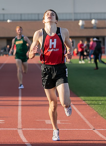 Huntley's Ian Geisler crosses the line first in the 3200 meter run Friday, April 20, 2018 at the McHenry County Track and Field Championship in Huntley. KKoontz – For Shaw Media