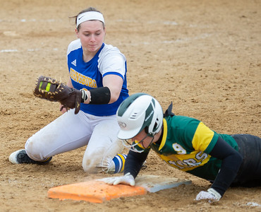 Crystal Lake South's Carly Chovanc slides under the tag of Johnsburg's Mckenna Diedrich Saturday, April 21, 2018 in Woodstock. Crystal Lake won the semi-final game of the Woodstock tournament beating Johnsburg 18-2. KKoontz- For Shaw Media