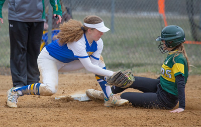 Crystal Lake South's Evelyn Smith slides under the tag of Johnsburg's Kate Linkletter Saturday, April 21, 2018 in Woodstock. Crystal Lake won the semi-final game of the Woodstock tournament beating Johnsburg 18-2. KKoontz- For Shaw Media