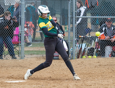 Crystal Lake South's Tina Toniolo hits a double and knocks in a run during the finals of the Woodstock Softball Tournament Saturday, April 21, 2018 in Woodstock. Crystal Lake South went on to win the tournament with a 12-0 shutout over Portage. KKoontz- For Shaw Media