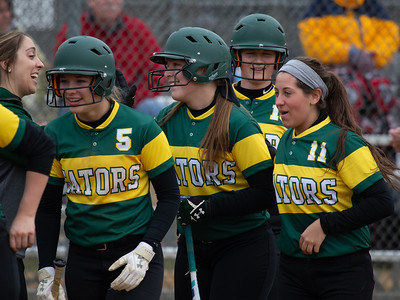 Crystal Lake South teammates celebrate with Baylee Kassel after her first inning three-run homerun during the finals of the Woodstock Softball Tournament Saturday, April 21, 2018 in Woodstock. Crystal Lake South went on to win the tournament with a 12-0 shutout over Portage. KKoontz- For Shaw Media