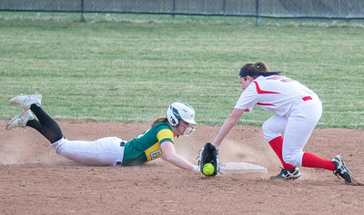 Crystal Lake South's Carly Chovanec beats the tag by Huntley's Paige Berkmeyer Monday, April 23, 2018 in Huntley. Huntley goes on to win 11-7, snapping the Gators five game winning streak. KKoontz- For Shaw Media