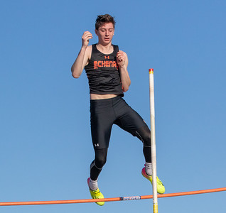 Max Schweitzer from McHenry High School clears 14 feet 3 inches to win the pole vault event at the McHenry County Track and Field Championship Thursday, April 19, 2018 in Huntley. His winning jump was 43 feet 9 inches.  KKoontz – For Shaw Media