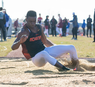 Maki Mohr from McHenry High School competes in the triple jump at the McHenry County Track and Field Championship Thursday, April 19, 2018 in Huntley.  KKoontz – For Shaw Media