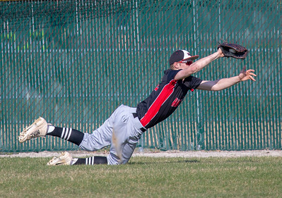 Huntley's Hunter Rumachik makes a diving catch in the outfield against Cary-Grove Tuesday, April 24, 2018 in Cary. Cary went on to win the close contest 3-0.  KKoontz – For Shaw Media