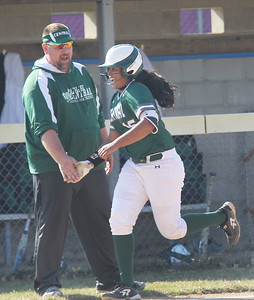 Candace H. Johnson-For Shaw Media Grayslake Central's Jason Schaal, head coach, congratulates Elisabeth Koshy on her home run against Wauconda in the first inning at Wauconda High School. Grayslake Central won 12-1.(4/24/18)