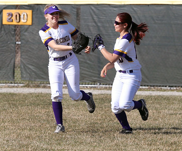 Candace H. Johnson-For Shaw Media Wauconda's Sydney Rodgers celebrates her catch in the outfield with Angelica Cho against Grayslake Central in the first inning at Wauconda High School. Grayslake Central won 12-1.(4/24/18)