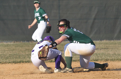 Candace H. Johnson-For Shaw Media Wauconda's Maggie Bonefas slides in safely under the tag by Grayslake Central's Nicole Buerger at second in the fifth inning at Wauconda High School. Grayslake Central won 12-1.(4/24/18)