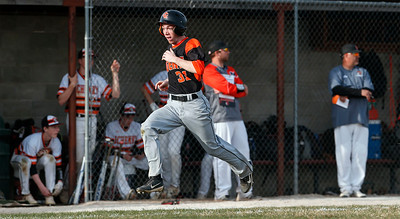 James Mills (31) from Crystal Lake Central scores in the sixth inning of their game against McHenry at Peterson Park on Thursday, April 26, 2018 in McHenry, Illinois. The Tigers defeated the Warriors 9-0. John Konstantaras photo for Shaw Media