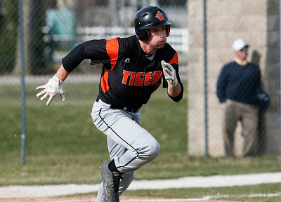 Jacob Staples (3) from Crystal Lake Central runs out an RBI double during the third inning of their game against McHenry at Peterson Park on Thursday, April 26, 2018 in McHenry, Illinois. The Tigers defeated the Warriors 9-0. John Konstantaras photo for Shaw Media