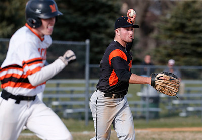 Jacob Staples (3) from Crystal Lake Central throws out Nick Finley (17) from McHenry during the third inning of their game at Peterson Park on Thursday, April 26, 2018 in McHenry, Illinois. The Tigers defeated the Warriors 9-0. John Konstantaras photo for Shaw Media