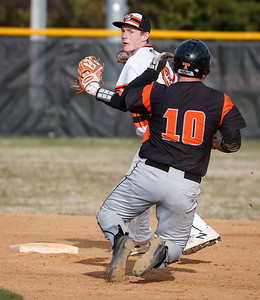 Carter Foat (12) from McHenry forces out Jeremy Laffoon (10) from Crystal Lake Central on the front half of a double play during the fifth inning of their game at Peterson Park on Thursday, April 26, 2018 in McHenry, Illinois. The Tigers defeated the Warriors 9-0. John Konstantaras photo for Shaw Media