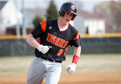 Alec Bolanowski (8) from Crystal Lake Central rounds the bases after his 2-run homer in the first inning of their game against McHenry at Peterson Park on Thursday, April 26, 2018 in McHenry, Illinois. The Tigers defeated the Warriors 9-0. John Konstantaras photo for Shaw Media