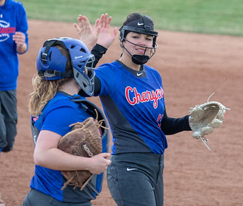 Dundee-Crown's Sydney Ruggles (R) and Claire Weeks (L) high five after a strike-out against Huntley Friday, April 27, 2018 in Huntley. Dundee-Crown went on to win the contest 4-2. KKoontz – For Shaw Media