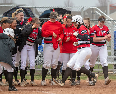 Huntley teammates celebrate a two-run homerun by Grace Kutz against Dundee-Crown Friday, April 27, 2018 in Huntley. It wasn't enough as Dundee-Crown went on to win the contest 4-2. KKoontz – For Shaw Media