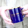 Ron Johnson holds a mug given away during a past anniversary promotion for the Blue Goose Market in St. Charles.