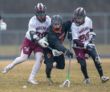 Crystal Lake Central's Brian Crowley (center) splits Prairie Ridge players Kyle Koelblinger (left) and Ian Fox (right) trying to gain possession on the ball Thursday, April 4, 2019 in Crystal Lake. Prairie Ridge went on to win 14-7. KKoontz – For Shaw Media