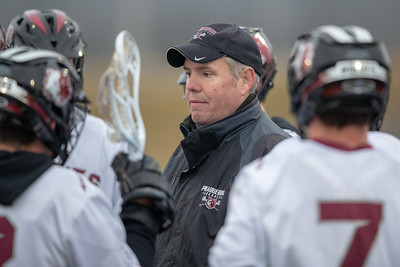 Prairie Ridge lacrosse head coach Josh Cole talks with his team during the game against Crystal Lake Central Thursday, April 4, 2019 in Crystal Lake.  KKoontz – For Shaw Media