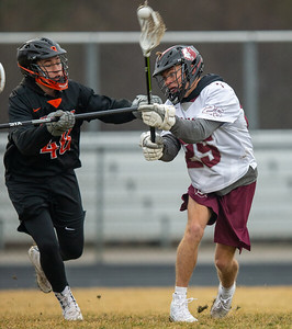 Prairie Ridge's Ben Wheeland takes a shot on goal in front of Crystal Lake Central's Patryk Pruszynski Thursday, April 4, 2019 in Crystal Lake. Prairie Ridge went on to win 14-7. KKoontz – For Shaw Media