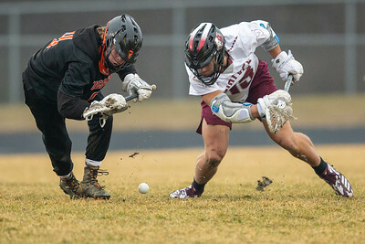 Crystal Lake Central's Mark Crowley (left) and Prairie Ridge's Zach Orr battle for possession during the face-off Thursday, April 4, 2019 in Crystal Lake. Prairie Ridge went on to win 14-7. KKoontz – For Shaw Media