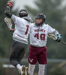 Prairie Ridge teammates Zach Clark (L) and Adam Diskin celebrate after Clark's fast-break goal in the first quarter against Crystal Lake Central Thursday, April 4, 2019 in Crystal Lake. PR went on to win 14-7. KKoontz – For Shaw Media