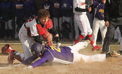 Candace H. Johnson-For Shaw Media Grant's Joe Gorden puts the tag on Wauconda's Riley Kirk for an out at home in the second inning at Grant Community High School in Fox Lake. Grant won 15-8. (4/2/19)