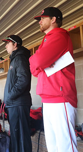 Candace H. Johnson-For Shaw Media Grant's Jake Mitchell, volunteer coach, and Dave Behm, head coach, stand on a bench in the dugout as they watch their varsity baseball players play against Wauconda in the seventh inning at Grant Community High School in Fox Lake. Grant won 15-8. (4/2/19)