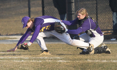 Candace H. Johnson-For Shaw Media Wauconda's Riley Kirk goes down with the catch along with Camden Janik against Grant in the fifth inning at Grant Community High School in Fox Lake. Grant won 15-8. (4/2/19)