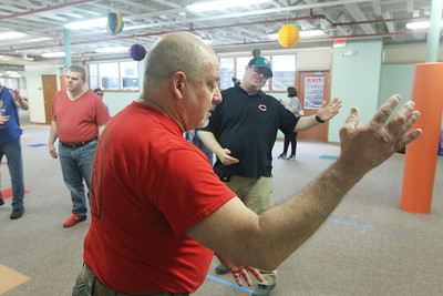 Candace H. Johnson-For Shaw Media Sean Hatch, 35, of Waukegan watches Eric Deveau, of Waukegan, owner and instructor of the Gurnee Martial Arts Academy, as he learns balance and focus during a Tai Chi class at Warren Special Recreation Association (WSRA) on Greenleaf street in Gurnee. (3/13/19)