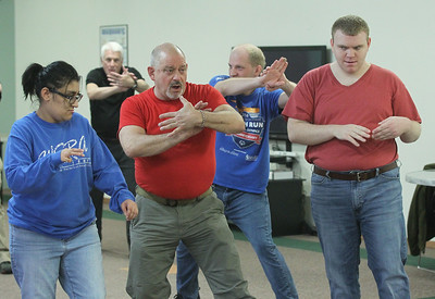 Candace H. Johnson-For Shaw Media Eric Deveau, of Waukegan (second from left) teaches a Tai Chi class at Warren Special Recreation Association (WSRA) in Gurnee. Deveau is the owner of Gurnee Martial Arts Academy. (3/13/19)