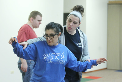 Candace H. Johnson-For Shaw Media Yoanna Guevara, 28, of Grayslake gets some help from Amber Bodame, CTRS, recreation coordinator,  during a Tai Chi class at Warren Special Recreation Association (WSRA) in Gurnee. Tyler Flowers, 24, of Gurnee is behind them. (3/13/19)