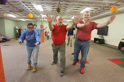 Candace H. Johnson-For Shaw Media Eric Deveau, of Waukegan (center) teaches Tai Chi to Yoanna Guevara, 28, of Grayslake and Tyler Flowers, 24, of Gurnee which helps them with balance and focus at Warren Special Recreation Association (WSRA) on Greenleaf street in Gurnee. Deveau owns the Gurnee Martial Arts Academy. (3/13/19)