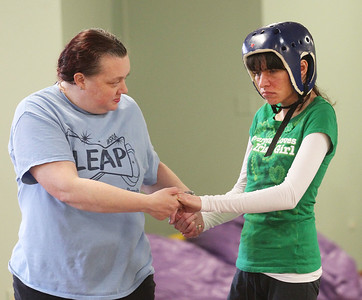 Candace H. Johnson-For Shaw Media Toni Naber, of Gurnee, program assistant, helps Katie Stagg, 30, of Round Lake during a Tai Chi class at Warren Special Recreation Association (WSRA) on Greenleaf street in Gurnee. (3/13/19)