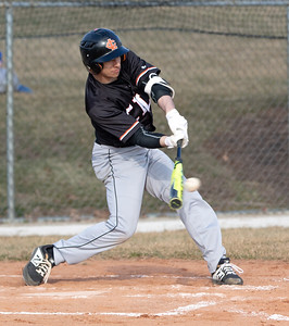 Crystal Lake Central's Dean Mlaka hits a single and drives in two runs in the fourth inning against Woodstock Friday, April 5, 2019 in Woodstock. Central blanked the Blue Streaks 13-0 in five innings.  KKoontz – For Shaw Media